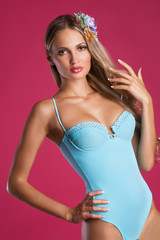 Pretty woman in blue fashionable swimsuit
