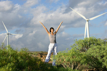 Woman in front of a wind farm