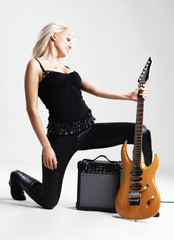 Gorgeous woman with electric guitar