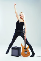 Expressive woman with electric guitar