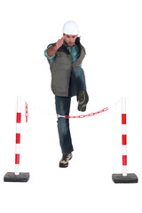 Man jumping over chain