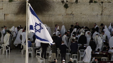 Stock Video Footage of male Jews at the Western Wall filmed in Israel at 4k with Red.