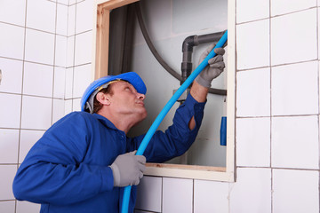 plumber connecting a water pipe