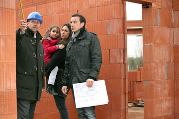 Family having their new home inspected by an engineer