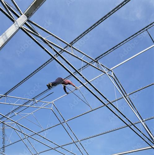 Construction worker building a glasshouse