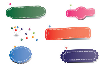Blank pinned stickers with different colors over white