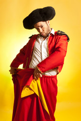 Bullfighter courage red yellow humor spanish colors