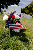 Headstone and American Flag at National Cemetery poster