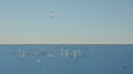 mirror and soap bubbles in the evening sky space