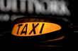 taxi sign by night
