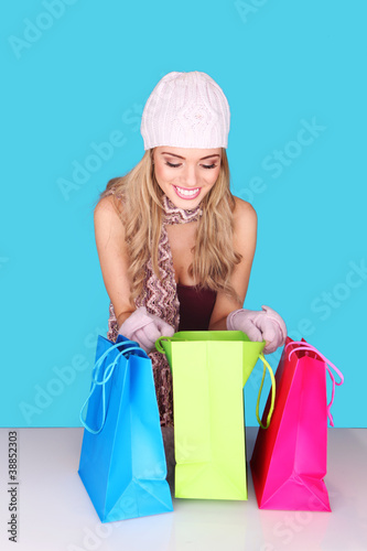 Excited Woman Looking In Shopping Bag