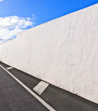 white wall withpart of street gives a harmonic pattern poster