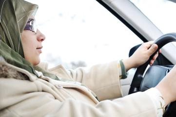 Muslim Arabic woman driving car