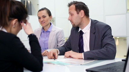 Female client in bank talking with business consultants