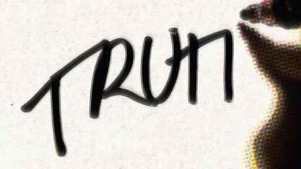 Writing the Word TRUTH on Paper