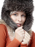 Close up of a freezy young woman with pelt cap poster