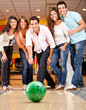 Group of friends bowling