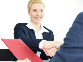 Pretty woman shakes hand for the good job interview