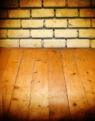 Vintage brick wall and wooden floor