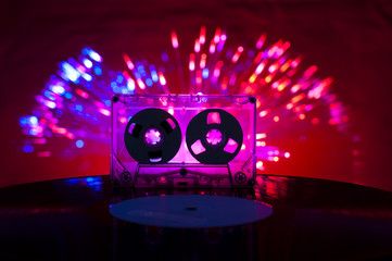 LP vinyl record, cassette tape and disco lights