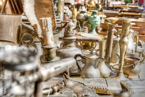 canvas print picture Brass antiques at a market stall. High dynamic range image.