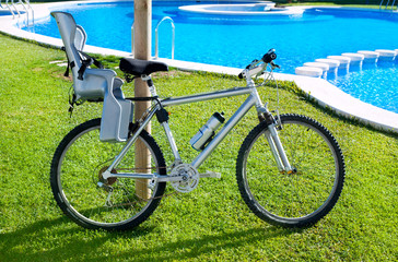 bicycle with baby seat in grass pool outdoor