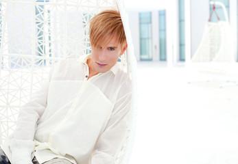 blond modern man portrait in summer terrace