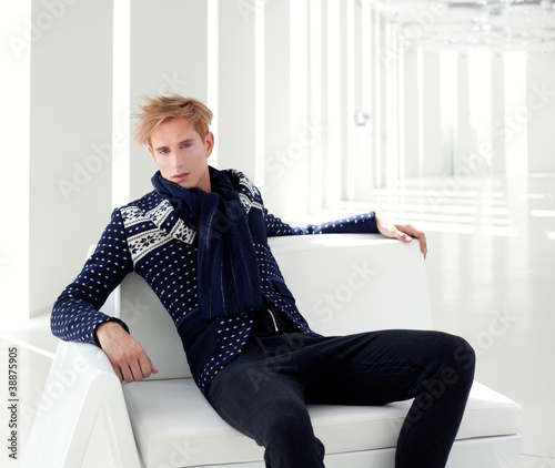 modern blond male futuristic sci-fi sitting