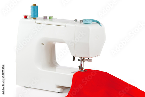Sewing machine with a red fabric on a white background
