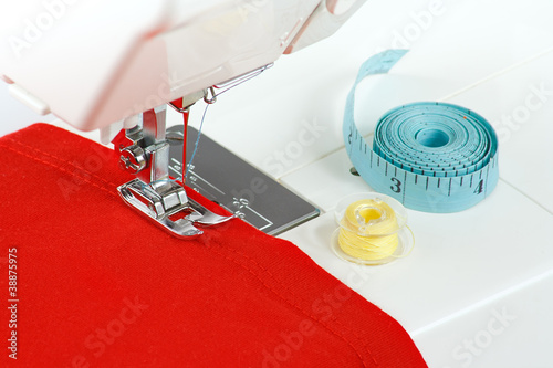 Sewing machine with a red fabric closeup