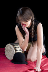 Young teen caucasian girl with hands on drum