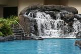 Fototapety Swimming Pool Lava Rock Waterfall