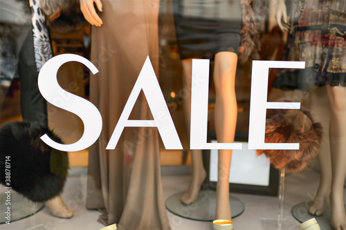 Sale sign in a fashion shop window