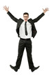 Happy businessman jumps in black suit on white.
