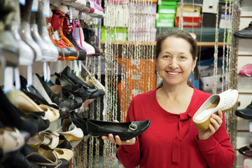 Mature woman chooses shoes