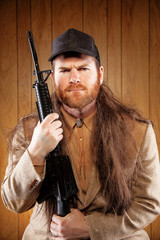 Southern Hick with a rifle and flowing hair