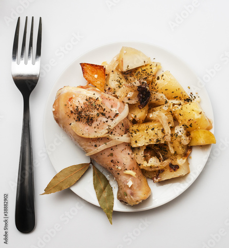 Grilled chicken wings served with potato