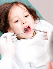 young girl have a dental examination