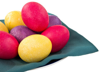 Easter eggs on napkin isolated on white
