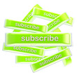 Pile of glossy bright subscribe buttons isolated