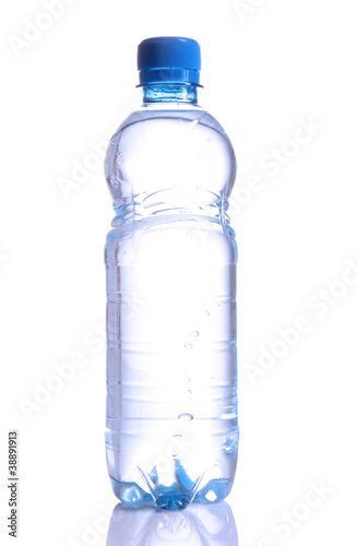 Fresh water splashing out of bottle, isolated on white backgroun