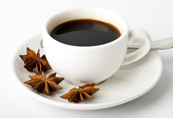 cup of coffee, anise on white background