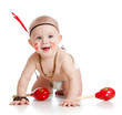smiling boy baby  as indian  boy with maracas and feather