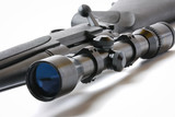 black hunting rifle with optics isolated on white poster