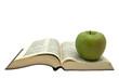 Библия и яблоко на белом фоне