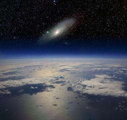 The Earth in space and the Andromeda galaxy.