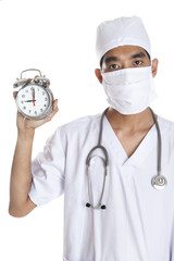 Doctor with alarm clock