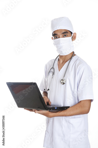 Doctor with laptop over white background