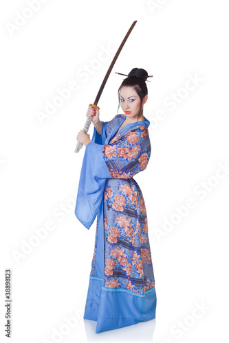 Beautiful woman in a kimono with samurai sword