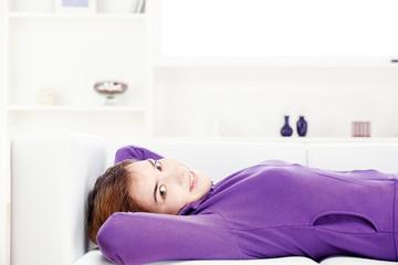 girl lying on sofa at home